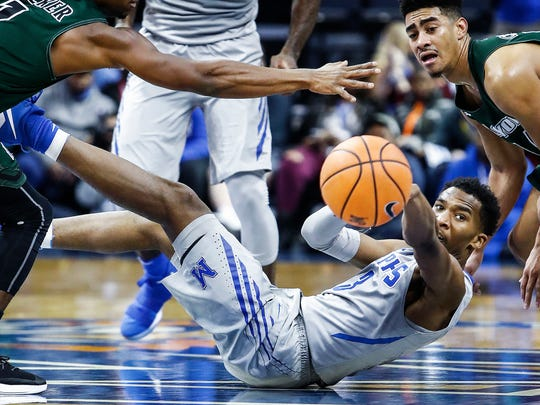 Memphis guard Jeremiah Martin (middle) makes a pass in front of Loyola defender Chuck Champion (right) during first half action at the FedExForum in Memphis Tenn., Saturday, December 23, 2017.