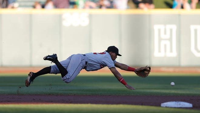 Indianapolis Indians shortstop Gustavo Nunez (12) can't get to this ground ball during the first game of the Governors' Cup Championship between the Clippers and the Indianapolis Indians at Huntington Park on Tuesday, September 15, 2015. (Columbus Dispatch photo by Jonathan Quilter)