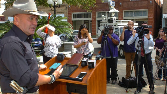 Capt. Clay Higgins announces his retirement from the St. Landry Parish Sheriff's Department during a press conference Monday on the steps of the St. Landry Parish Courthouse.