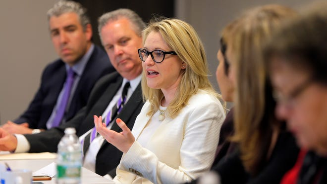 Sarah Adelman from the New Jersey Association of Health Plans speaks during the Asbury Park Press Business Roundtable on health care affordability in Neptune.