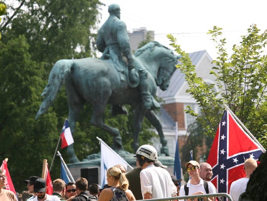 Unite the Right rally demonstrators gather around the