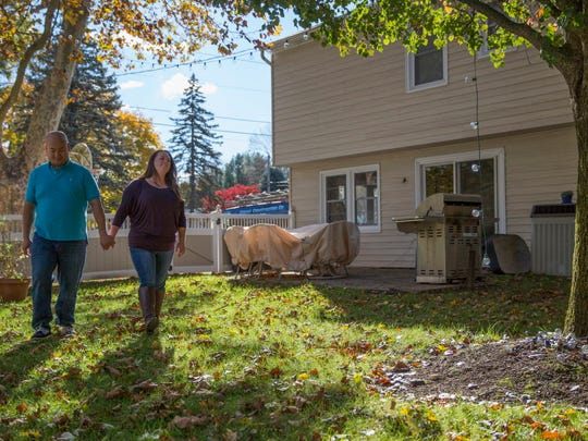 Thuat To and Briana Clauss, both 31, at their new home