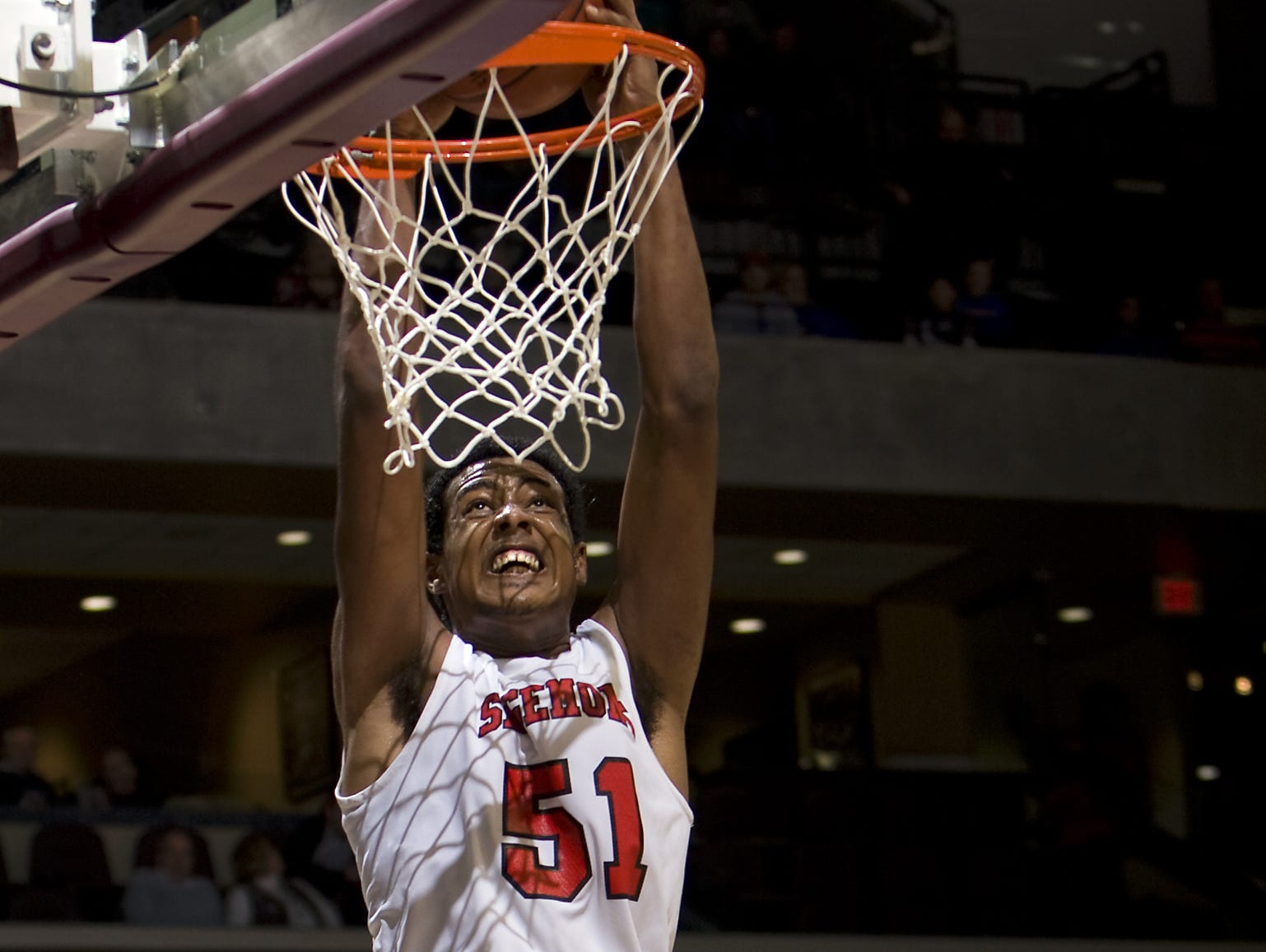 Sagemont High School center Fab Melo, left, dunks the basketball past the defense of United Faith Christian Academy during the fourth quarter of a 2010 Bass Pro Tournament of Champions basketball game at JQH Arena.