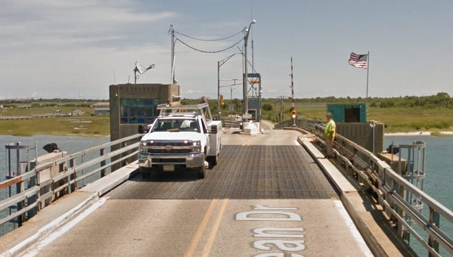 A driver was forced to gun his engine and jump New Jersey's Middle Thorofare Bridge drawbridge that began rising as he crossed it with his family.