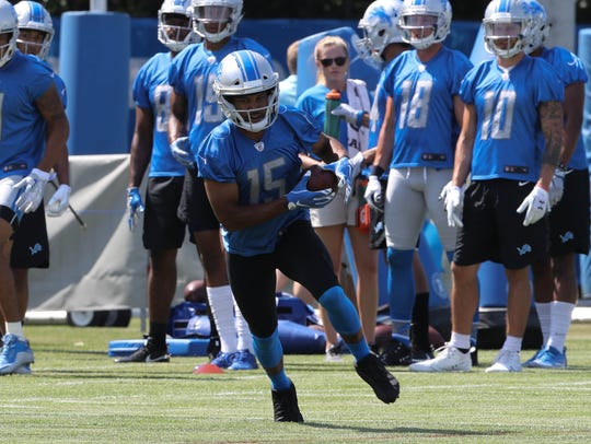 Lions receiver Golden Tate goes through drills during