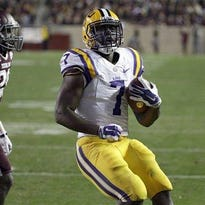 LSU running back Leonard Fournette (7) rushes for a touchdown as Texas A&M defensive back Deshazor Everett (29) defends during the second quarter of an NCAA college football game last season.