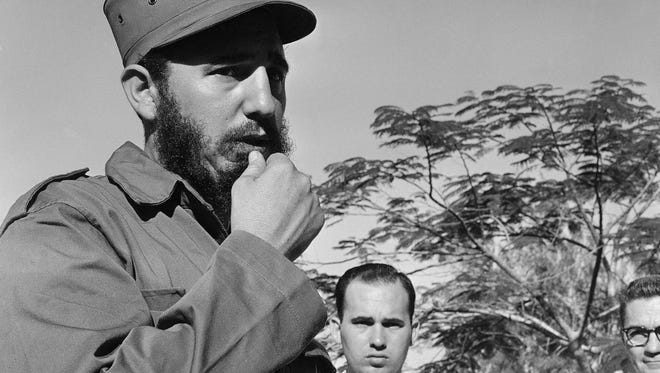 Fidel Castro, leader of the revolutionary forces now in control of Cuba, ponders a question during a brief meeting with the press on Jan. 5, 1959 in Camaguey, Cuba during stop en route to the capital in Havana.