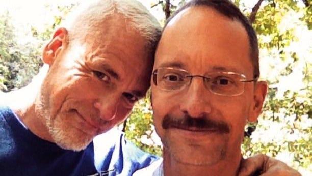 Scott Gubala, right, and his fiance, Phillip Hill