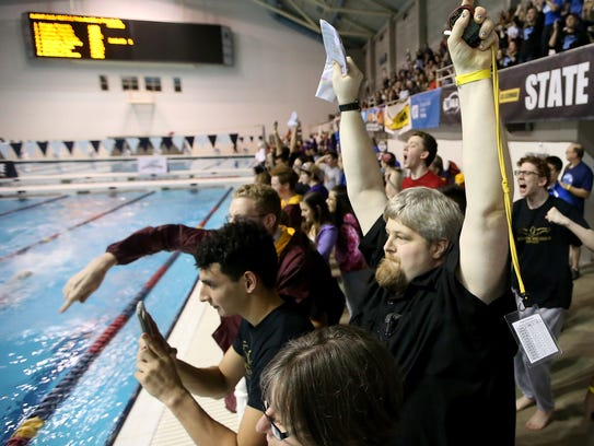 Kingston boys swim coach Mark VanHuis led the Buccaneers