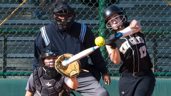 Bergen Tech sophomore Victoria Villanueva takes a big swing during one of the Knights games at Disney last week.