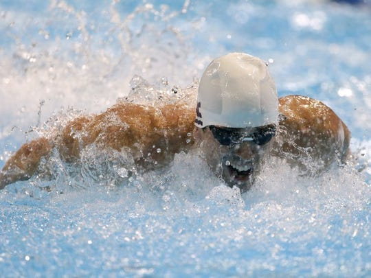 Davis Tarwater swims in a men's 100-meter butterfly semifinal at the U.S. Olympic swimming trials on Saturday, June 30, 2012, in Omaha, Neb. (AP Photo/Mark Humphrey)