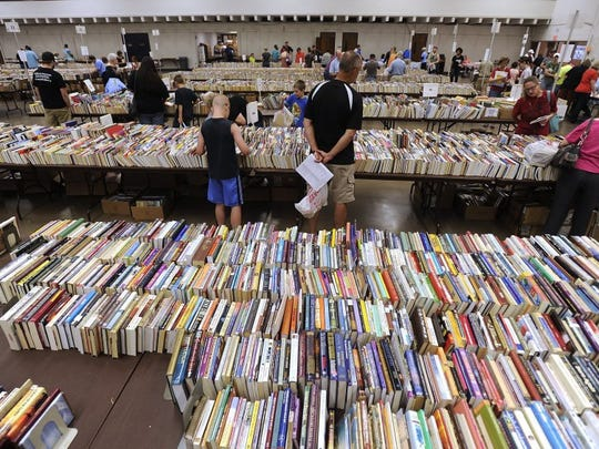 Thomas Metthe/Reporter-News People sift through the thousands of books available for sale during the 2015 Friends of the Abilene Public Library book sale at the Abilene Civic Center.