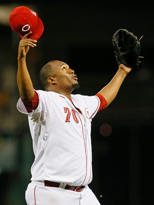 Reds relief pitcher Jumbo Diaz celebrates getting out of a jam during the top of the eighth inning Thursday against the Giants.