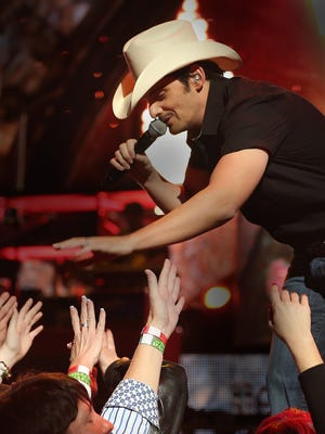 Brad Paisley gets close to his fans during a show in the Tucker Civic Center in 2014. Expect more of the same on Friday night.