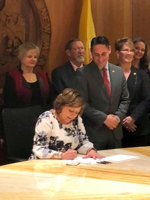 Senator Howie Morales smiles while watching Governor Susana Martinez sign during this past Legislative session.
