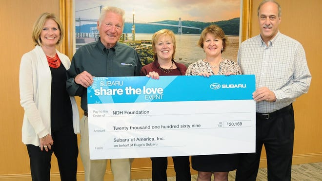 From left, Kristin Hutchins and Lewis Ruge of Ruge's Subaru present a donation to Northern Dutchess Hospital President Denise George, NDH Foundation Executive Director Dawn Morrison and NDH Medical Affairs Vice President Dr. John Sabia.