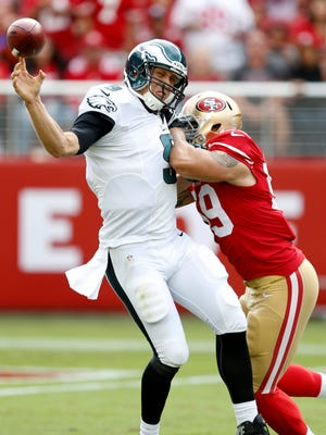 Aaron Lynch (59) and the 49ers defense got constant pressure on Eagles quarterback Nick Foles (9).