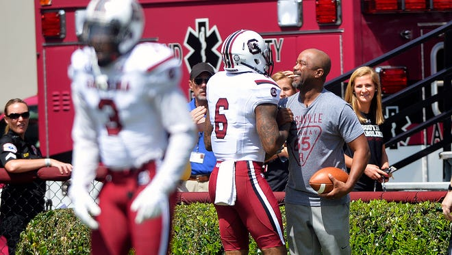 Darius Rucker scores the first touchdown of the game during the Garnet & Black Spring Game at Williams-Brice Stadium in Columbia on Saturday, April 11, 2015.