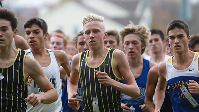 Watkins Memorial's Andrew Jordan runs with the pack at the start of the Division I district race in October.