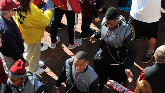 USC linebacker Skai Moore (10) makes his way into Williams-Brice Stadium before hosting the Florida Gators in Columbia on Nov. 14, 2015.