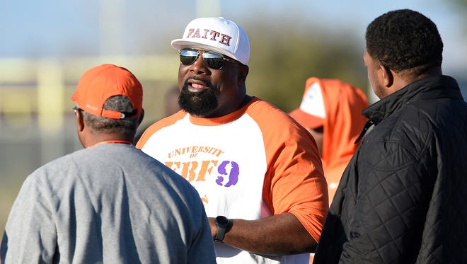 Arizona Cardinals assistant coach Brentson Buckner watches the Clemson football team practice before the 2016 national championship game on Jan. 9, 2016 in Scottsdale, Arizona.