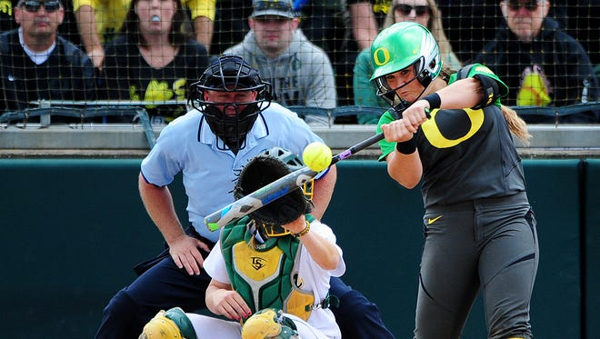 Oregon's Hailey Decker with a pop up against North Dakota State during the NCAA regional round at the University of Oregon, on Saturday, May 16, 2015, in Eugene. Oregon won the game 6-1.