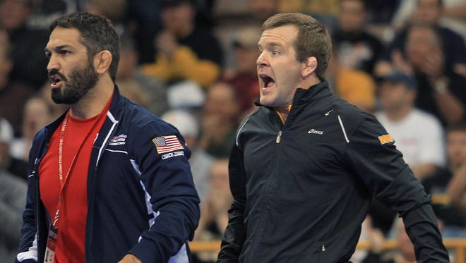 Bill Zadick, left, and Terry Brands offer support as Mike Zadick competes at the U.S. Olympic Wrestling Trials in 2012. Bill Zadick, a former Iowa wrestler, was named the Olympic Coach of the Year at Nov. 29, 2017 at the Team USA Awards in Los Angeles.