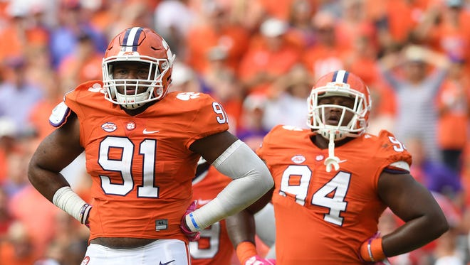 Clemson defensive lineman Austin Bryant (91) and defensive tackle Carlos Watkins (94) during the fourth quarter against N.C. State on Saturday at Clemson's Memorial Stadium.
