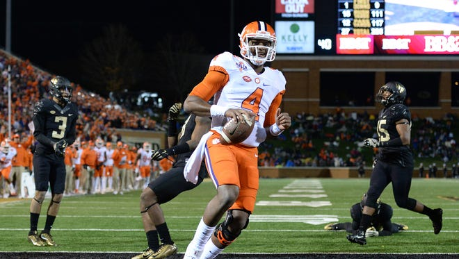 Clemson quarterback Deshaun Watson (4) scores a touchdown during the 2nd quarter at Wake Forest's BB&T Field on Saturday, November 19, 2016.