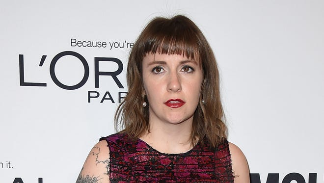 "FILE - In this Monday, Nov. 14, 2016, file photo, Lena Dunham arrives at the Glamour Women of the Year Awards at NeueHouse Hollywood in Los Angeles. ""Girls"" creator Dunham and author-essayist Ta-Nehisi Coates were strangers until this week, but are finding they have a lot in common. Dunham and Coates spoke on Monday, Dec. 5, at a New York City event sponsored by the MacDowell artist colony. (Photo by Jordan Strauss/Invision/AP, File) ORG XMIT: NY120"
