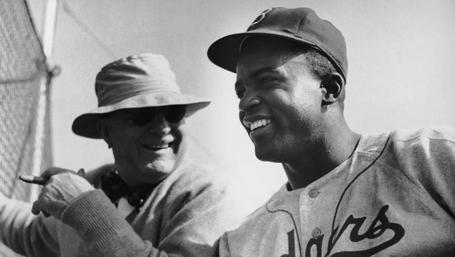 Brooklyn Dodgers president Branch Rickey with Jackie Robinson in 1949.