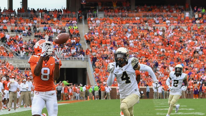 Clemson wide receiver Deon Cain (8) catches a TD past Wake Forest defensive back Amari Henderson (4) during the 1st quarter on Saturday, October 7, 2017 at Clemson's Memorial Stadium.