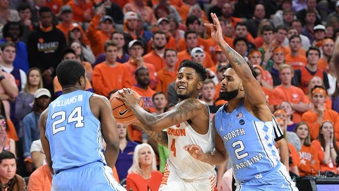 Clemson guard Shelton Mitchell (4) drives past North Carolina guard Joel Berry II (2) during the 2nd half on Tuesday, January 30,  2018, at Clemson's Littlejohn Coliseum.