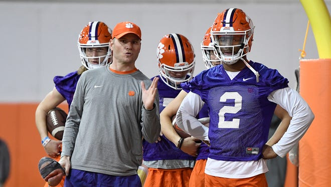 Clemson quarterbacks coach Brandon Streeter works with quarterback Kelly Bryant (2) during the Tigers opening day of spring practice on Wednesday, February 28, 2018.