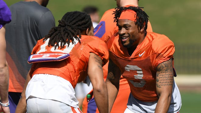 Clemson wide receivers T.J. Chase (18), left, and Amari Rodgers (3) during the team's practice on Wednesday, April 4, 2018 at Clemson's Memorial Stadium.