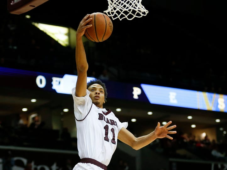 Missouri State's Jarred Dixon goes to the basket for
