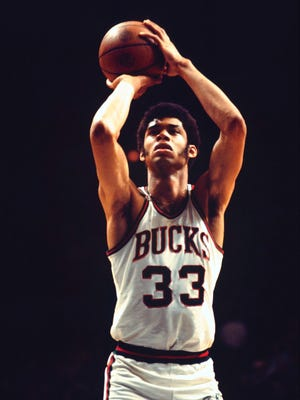 Lew Alcindor shoots a free throw for the Milwaukee Bucks in 1970. The following year he announced his conversion to Islam and changed his name to Kareem Abdul-Jabbar.