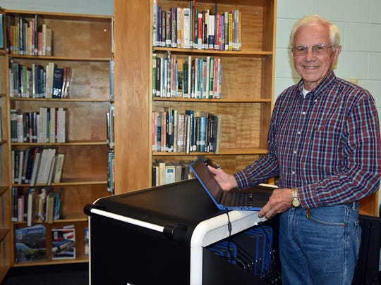 Gibbs High School Foundation president Roy Mullins, inside the GHS library with the new Chromebooks and charging station purchased for the school by the GHSF.