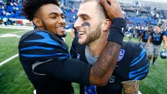 Memphis starting quarterback Riley Ferguson celebrates