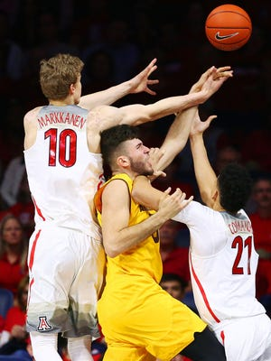 ASU forward Ramon Vila receives the double-team from Arizona's Lauri Markkanen (10) and Chance Comanche (21) during PAC-12 action on Jan. 12, 2017 at McKale Center in Tucson, Arizona.