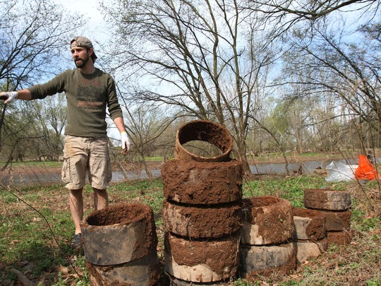 Joseph David of CJST - Central Jersey Stream Team, stands near some of the tires recovered as he and volunteers clean up the banks of the main stem of the Raritan River in Bridgewater.