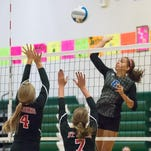 Jess Cadena of Harper Creek returns a serve Saturday morning at Pennfield High School for the Cereal City Volleyball Tournament.