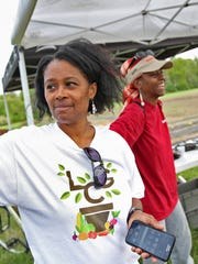 Sharrona Moore, left, with Lawrence Community Gardens,