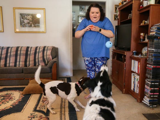 Tammy Van Stockum throws balls for Lily and Daisy Nov.