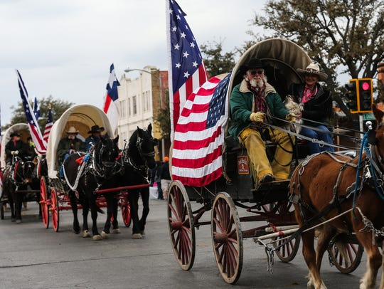 Santa Fe Trail Ride participants make their way down
