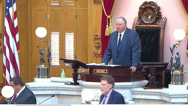 A mask-less Speaker Larry Householder presides over an Ohio House session earlier in the coronavirus pandemic.