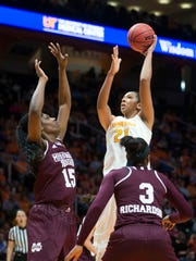 Tennessee's Mercedes Russell shoots overwhile defended by Mississippi State's Teaira McCowan at Thompson-Boling Arena on Sunday. Tennessee lost to Mississippi State, 73-64.