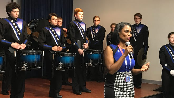 Reality star and future White House staff member Omarosa Manigault speaks to the staff of the Presidential Inaugural Committee during a surprise performance from the Columbus North High School band.