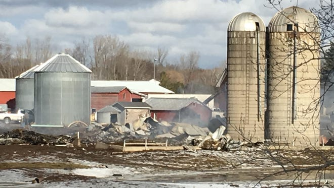A barn fire on on Pinecrest Road in Howard could continue to smolder for months due to concerns about the risk that damaged silos could fall on firefighters if they enter the area.