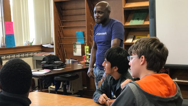Tech entrepreneur Peter Rotich talks to Bolton High School students about his company.